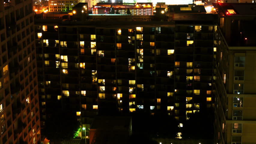 Time Lapse Of Apartment Building At Night Zoom In Stock Footage