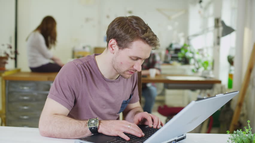 Portrait of a happy young male student, working in a shared study space | Shutterstock HD Video #5763251