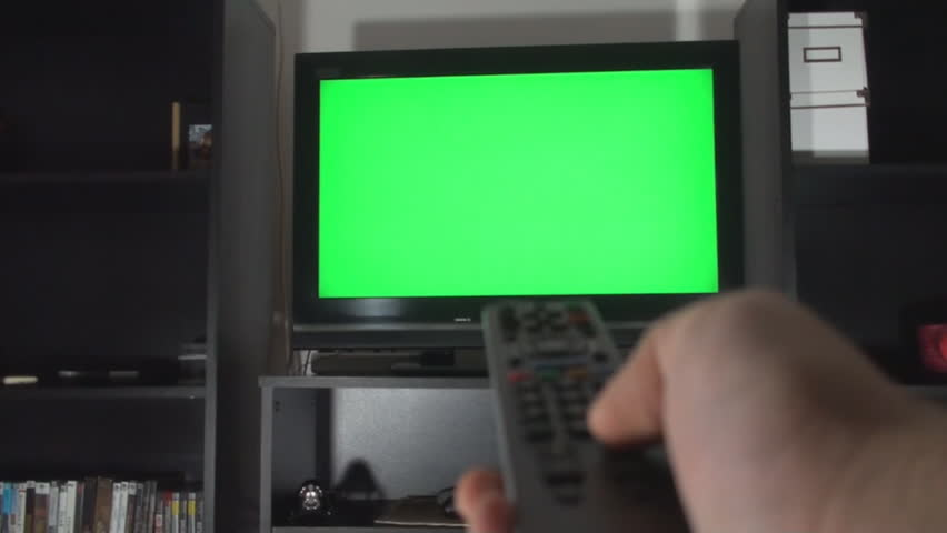 Male Hand With TV Remote Switching Channels On A Green Screen TV Point Of View | Shutterstock HD Video #5772539