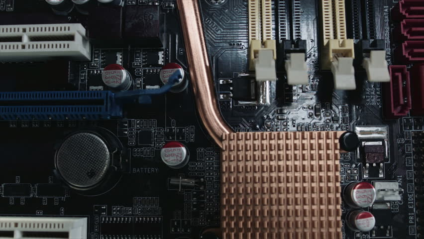 Computer Motherboard UHD Stock Footage. A close up dolly shot of a Computer Motherboard which is high in detail and texture. Colour rec709 Kodak 5213 Vis3 film  Red Epic