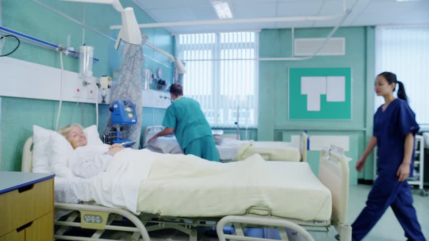 Caring medical team at the bedside of an elderly female patient. In slow motion. | Shutterstock HD Video #5782109