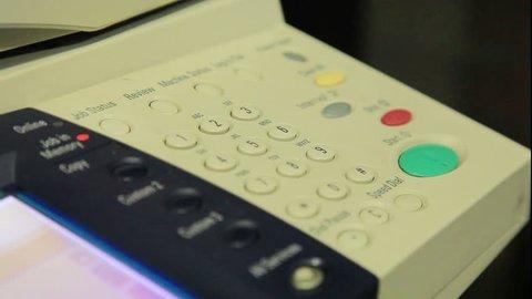Fax machine. Pushing buttons. Dialing