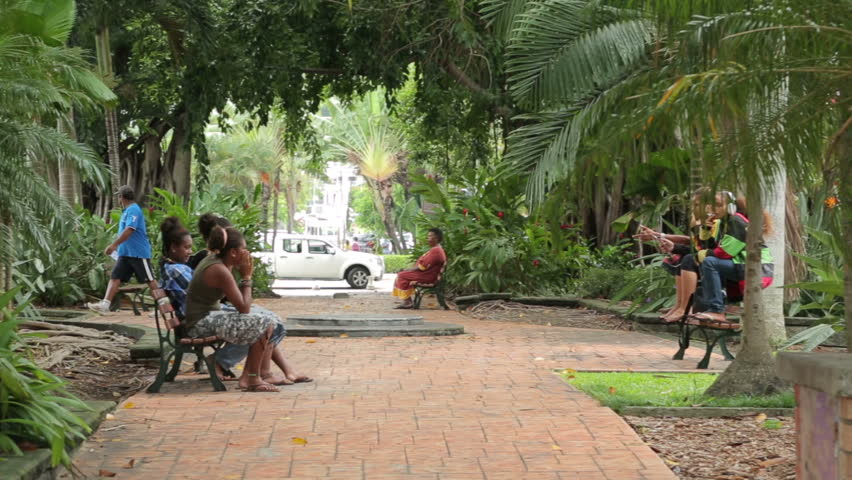NOUMEA, GRANDE TERRE/NEW CALEDONIA - FEBRUARY 06, 2014: Pan of local people in city park. The Kanaks are the indigenous Melanesian inhabitants of New Caledonia who want independence from French rule.