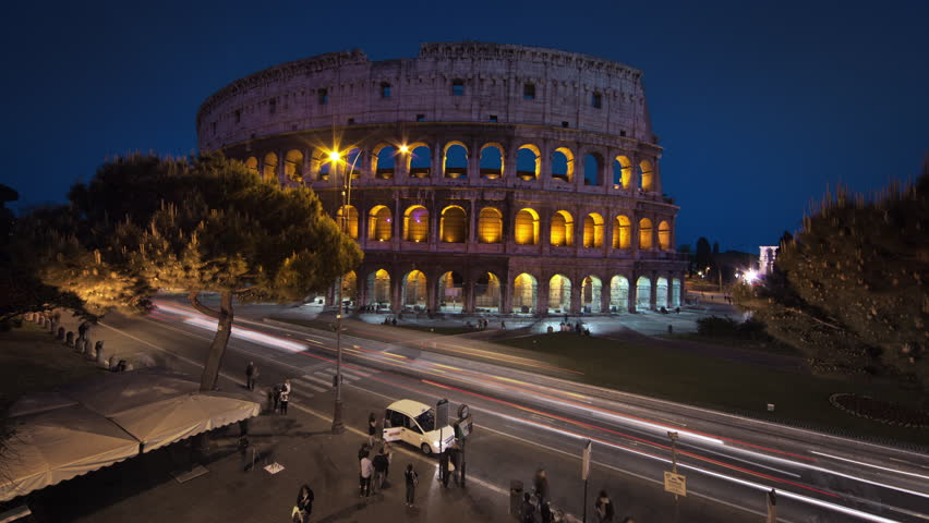 Nighttime time-lapse of the Colosseum and street traffic