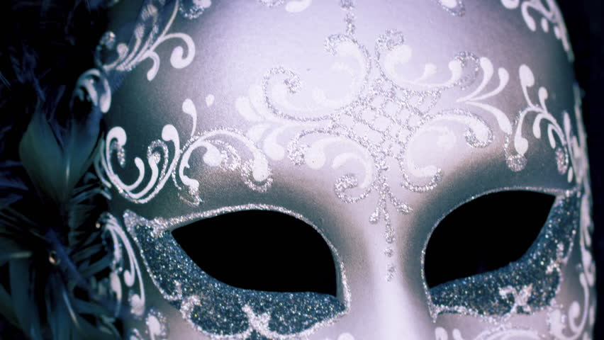 Close up tilting down shot of an elegant carnival mask