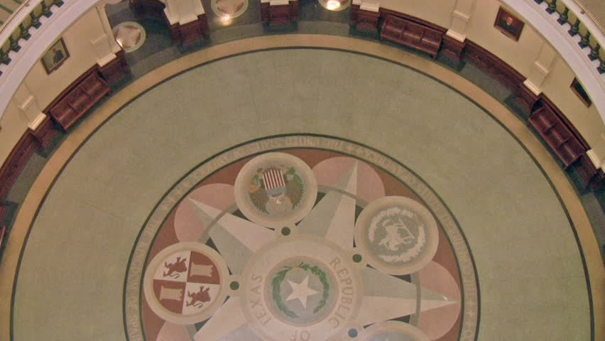 Video of State capital of Texas. Austin Texas. Inside government complex showing the historic designs. Rotunda dome with extensive decorations and numerous floor rails. Rotunda decorative tile floor