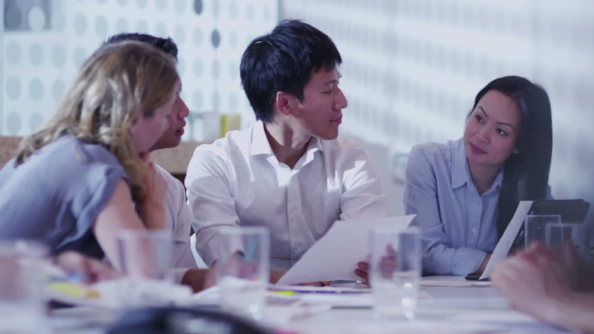 Attractive young multi ethnic business team in a boardroom meeting | Shutterstock HD Video #5843789