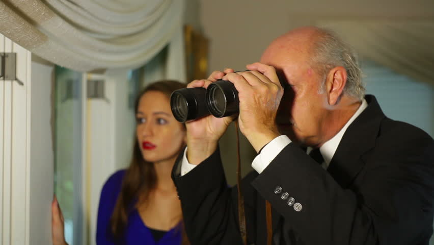 Nosey neighbors looking outside  Professional actor and runway model.