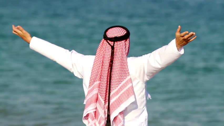 Arabian man,on the beach.Arab man walks along the sea
