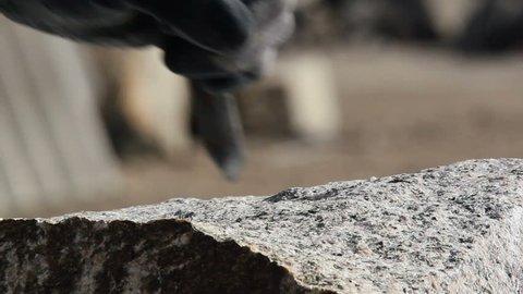 Stonemason is working on a sett