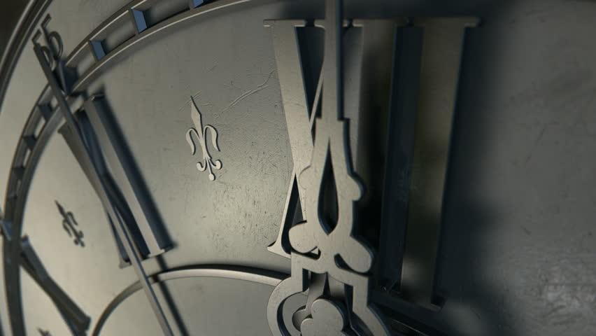 A macro closeup of an antique clock focusing on the second hand counting down ten seconds to midnight