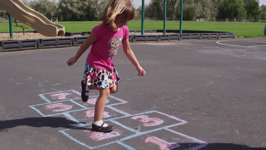 Little girl playing hopscotch at pre-school - 4K