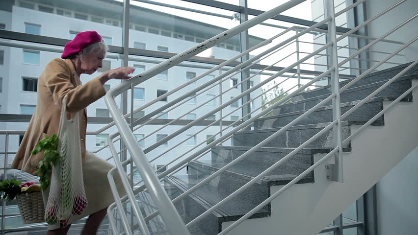 Old lady walks up the stairs