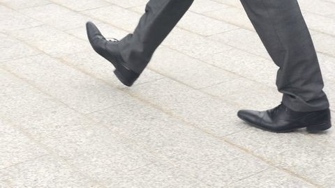 Slow Motion Rear-view Of Businessman Entering Office Building.