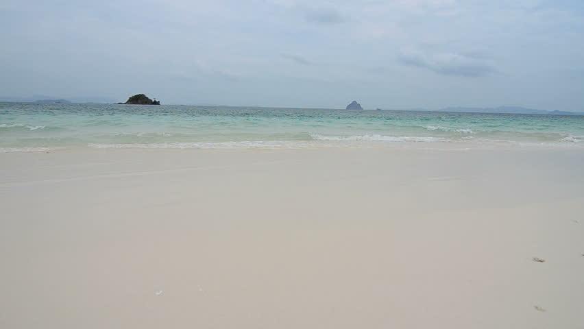Sea waves over sand beach at khai nok island, Phung Nga,Thailand