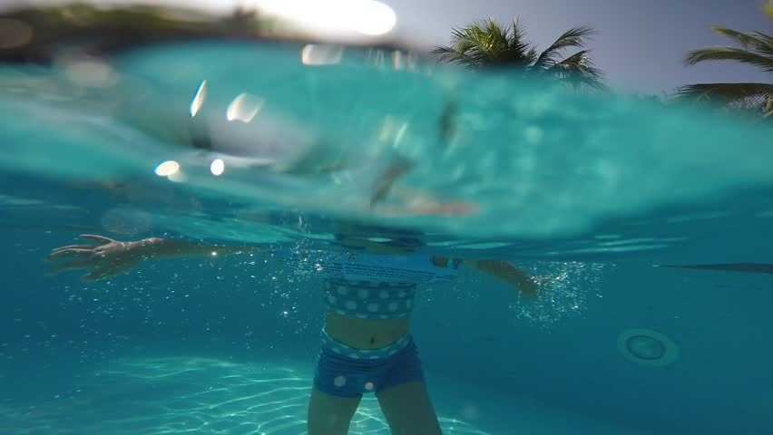 Asian Chinese Little Girl Child Playing Inside Swimming Pool With