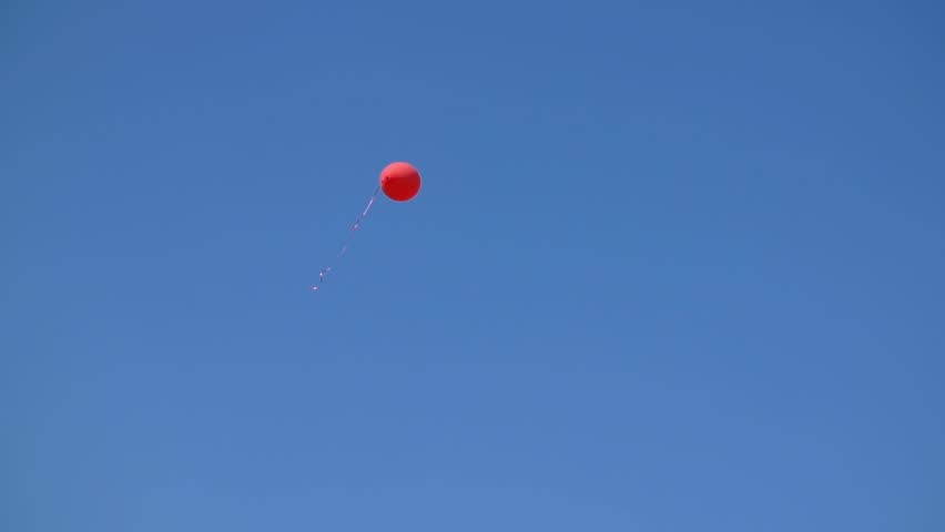 Red Balloon Flying In Blue Sky