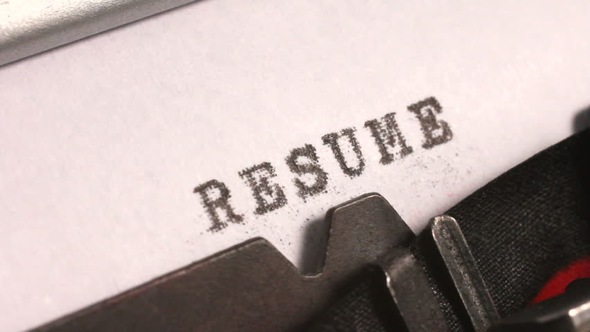 Stock Video Clip of Typing a Resume or Curriculum Vitae of