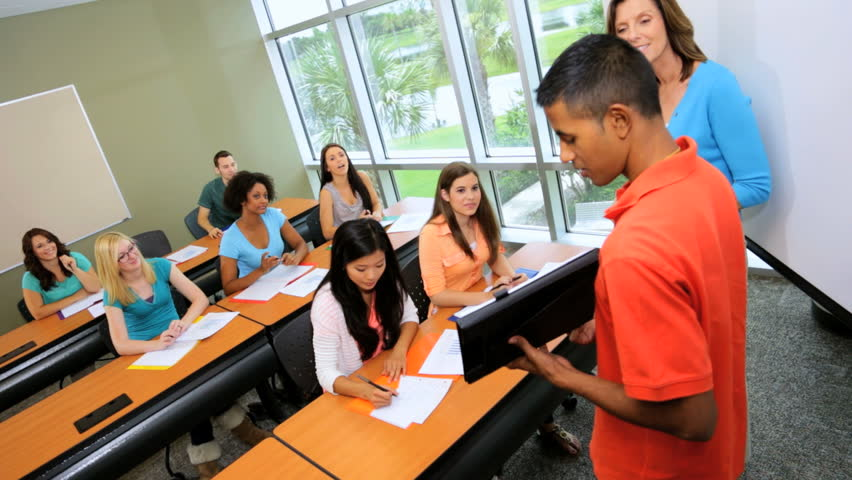 Classroom Presentation Ideas ~ Caucasian female college tutor teaching class multi ethnic