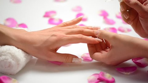 Manicure. Nail Polish. Woman in a Beauty Salon receiving a manicure by a beautician. HD video footage
