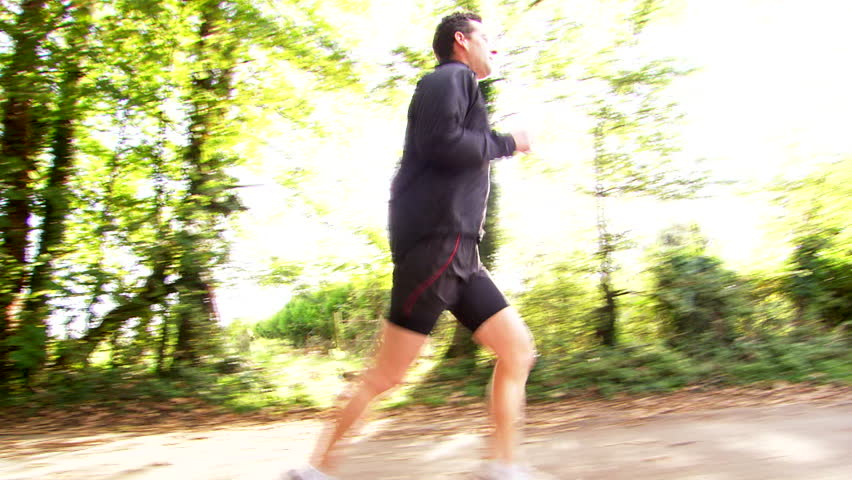Tracking shot of jogger running with sun flares      #6015449