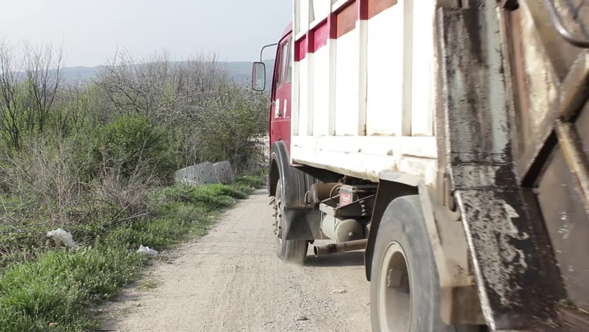 1/35 Garbage truck transported and disposed trash on the landfill. Vehicle transporting garbage to waste.Truck disposing of garbage at dump.Ecological disaster.Enviromental.Footage available in 25fps.