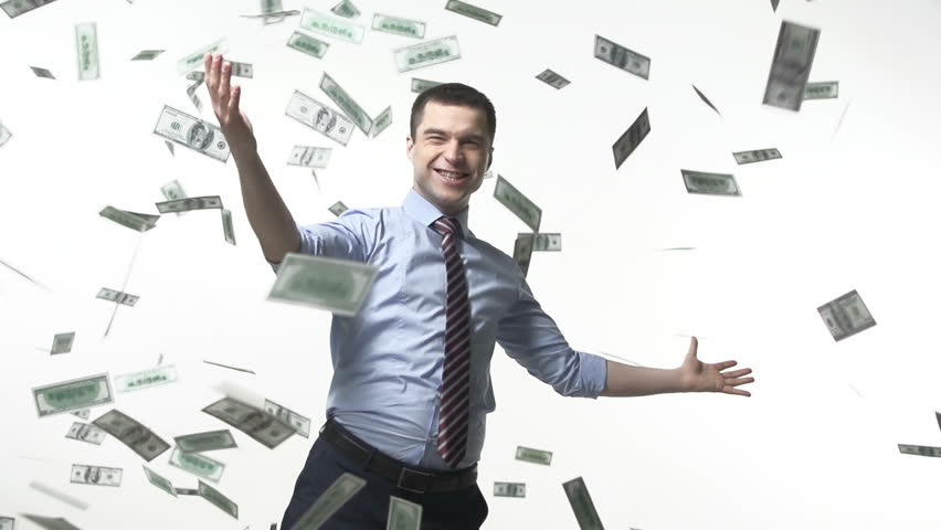 Man triumphing under falling bills | Shutterstock HD Video #6071129