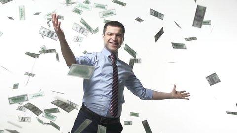 Man triumphing under falling bills