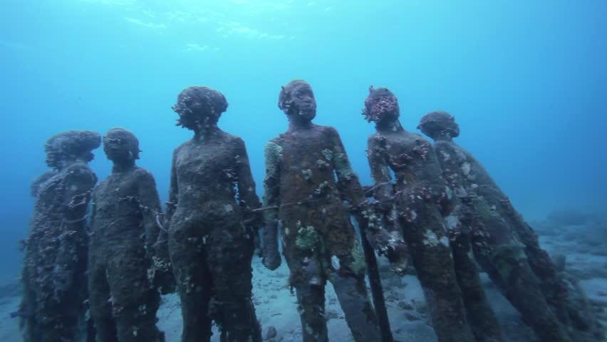Medium Shot Underwater sculptures on bottom of sea / Grenada, Caribbean Sea