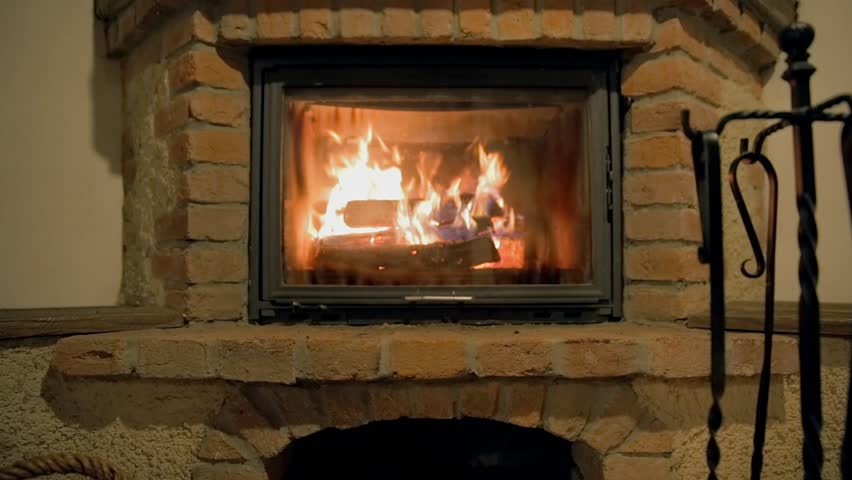 A Real Wood Fire Burning In A Clean Brick Fireplace, Winter Home ...
