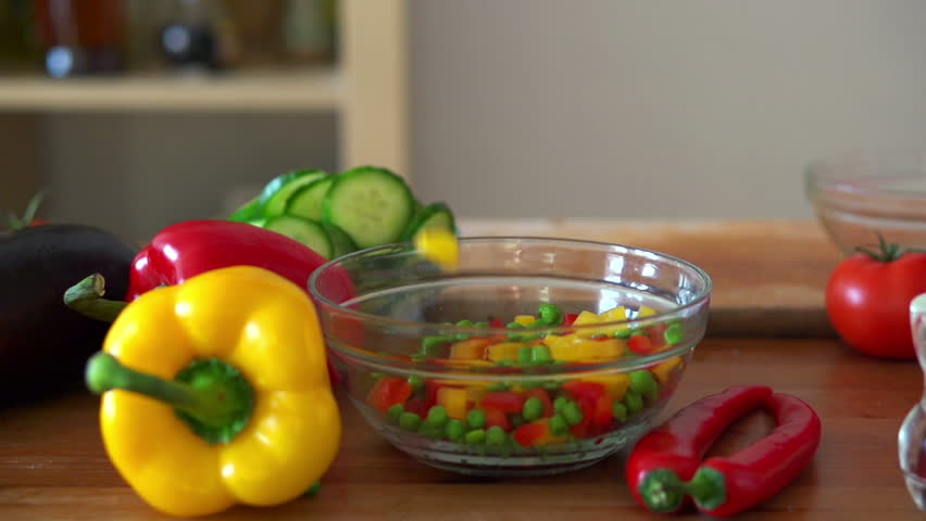 components of vegetables salad  falling into bowl, super slow motion, shot at 240fps