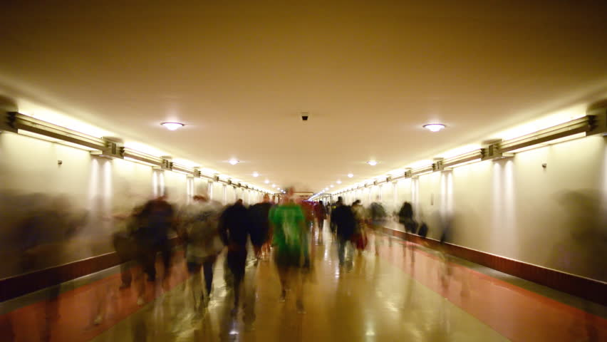 Time Lapse of Union Station Hallway with Commuters in Motion Blur -Tilt Down-