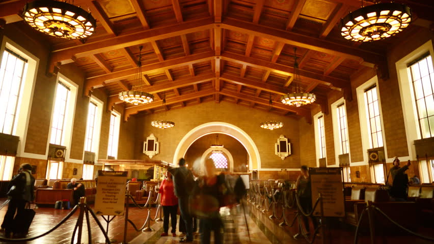 Time Lapse of Historic Union Station in Los Angeles with Commuters in Motion Blur -Tilt Up-