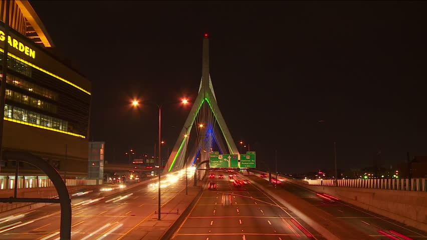 Timelapse view of traffic crossing the Leonard P. Zakim Bunker Hill Memorial Bridge at night in Boston, Massachusetts.