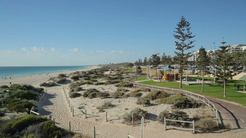 Pan over Scarborough beach and sand dunes, Perth, Australia