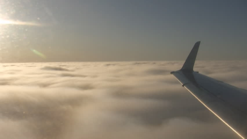Commercial airplane flying into the clouds