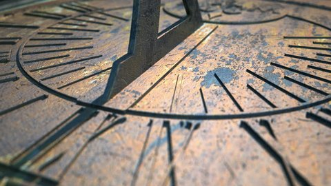 A macro closeup time-lapse of a camera panning across a metal sundial with time passing over a day