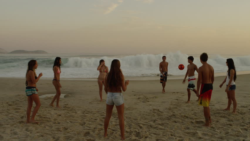 RIO DE JANEIRO, BRAZIL - JUNE: A group of teens playing soccer (football) on Ipanema beach