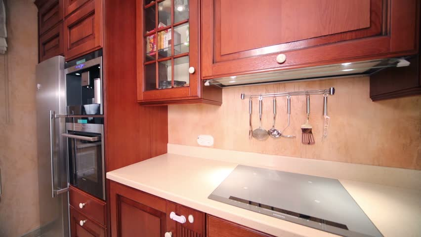 Modern Furniture Video interior of modern kitchen with beige furniture and stove stock