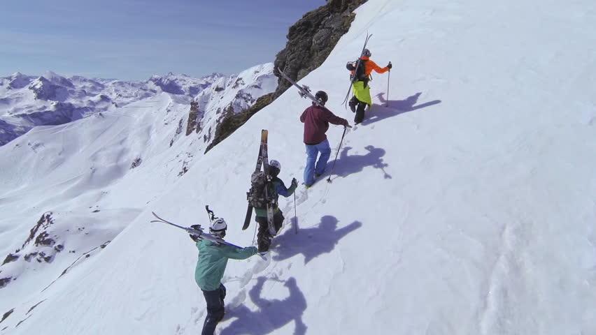 AERIAL: Skiers walking uphill | Shutterstock HD Video #6157205