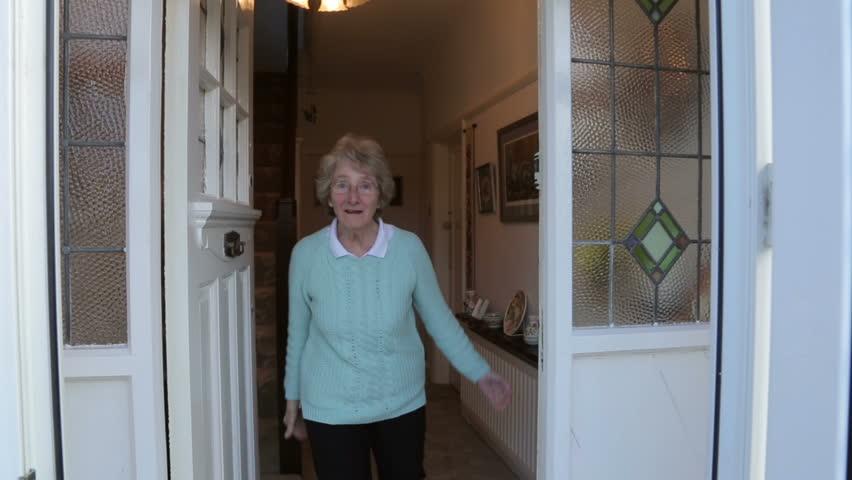 Stock video of senior woman opens front door and | 6212879 | Shutterstock  sc 1 st  Shutterstock & Stock video of senior woman opens front door and | 6212879 ...
