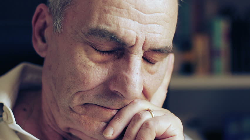 pensive and sad old man looking at the camera - depressed