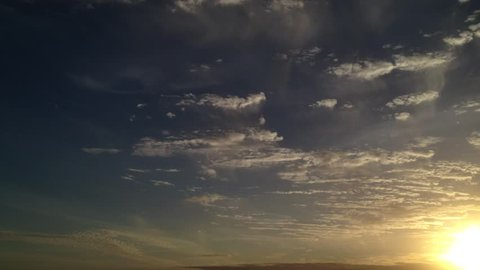 Aerial pan shot over clouds during beautiful sunset Time-lapse