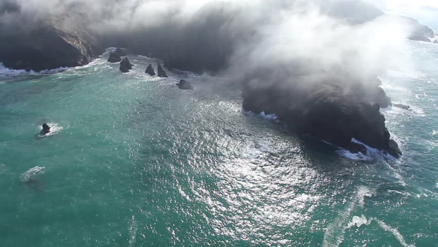 Aerial fly over of the fog over a rocky coastline | Shutterstock HD Video #6242708