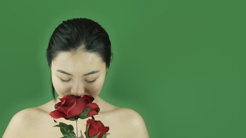 Asian girl naked beauty young adult isolated greenscreen green background romance rose happy