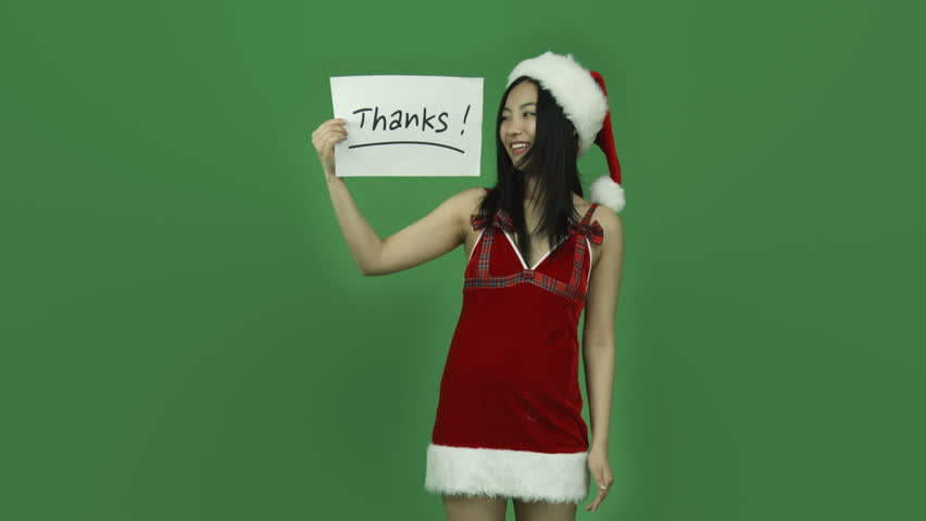 Asian girl sexy santa claus isolated greenscreen green background grateful with thanks sign | Shutterstock HD Video #6250439