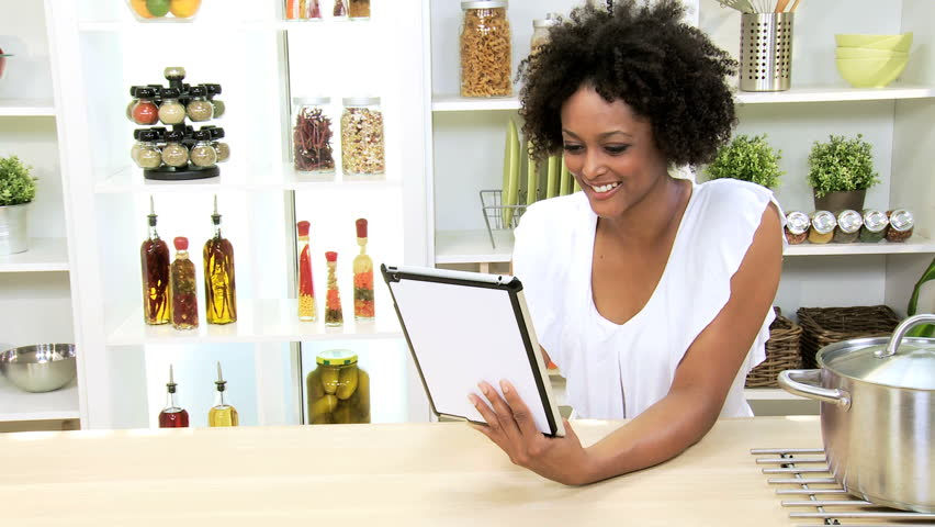 African American Girl Home Kitchen Wireless Tablet - Young African American girl sitting relaxing home kitchen counter social networking wireless tablet | Shutterstock HD Video #6329189