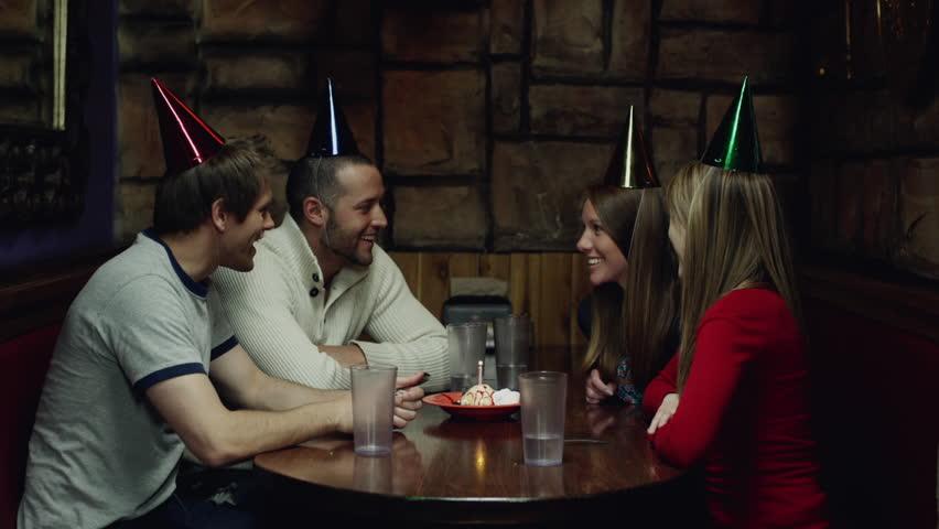 Medium Shot Friends celebrating woman's birthday in restaurant  | Shutterstock HD Video #6331559