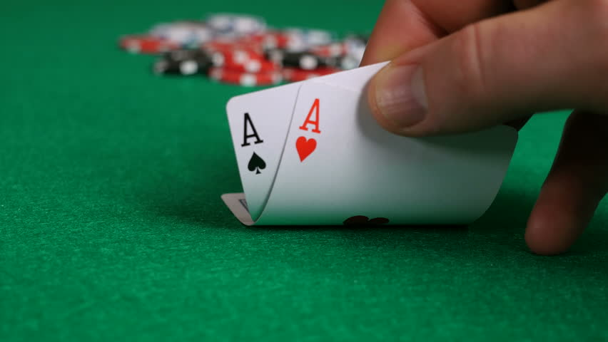 Poker Player with Pocket Aces Considers His Move As Attention Shifts From Cards To Chips