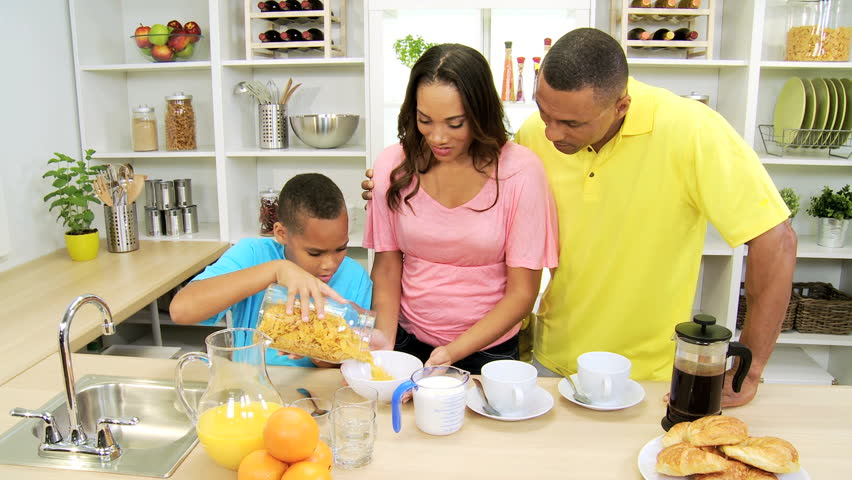 Happy Young African American Family Home Breakfast
